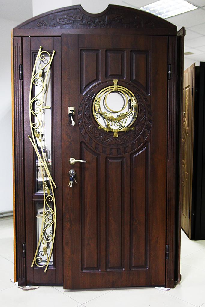 Двери входные двополые с ковкой.